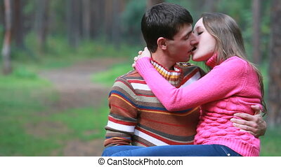 Happy sweethearts - Man holding his girlfriend in hands,...