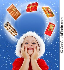 Boy looking to copy space surrounded by gifts