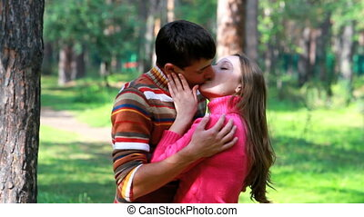 Sweet kiss  - Young passionate couple kissing outdoors