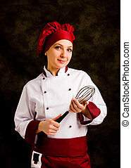 Chef with whip - photo of young successful female chef with...