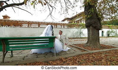 Muslim newlyweds - Crimean Tatar newlyweds walking through...