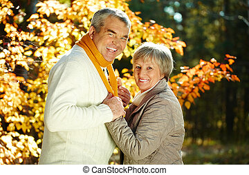 Autumn weekend - Photo of happy aged man and woman looking...