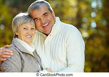Bonding - Photo of amorous aged man and woman looking at...