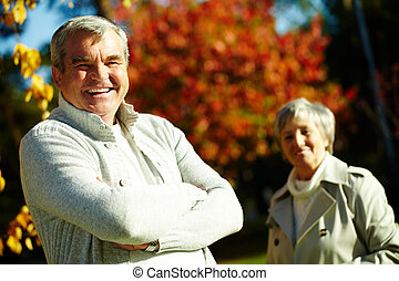 Happy man - Photo of happy aged man looking at camera with...