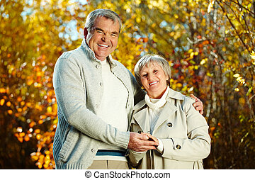 Happiness - Photo of happy aged man and woman looking at...