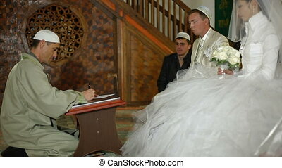 Muslim wedding ceremony Nikah - Mullah preaching at the...