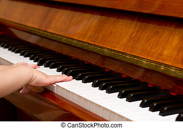 Small child playing piano