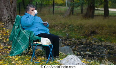 Caffee break - senior woman drinking coffee,  Side View
