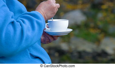 white coffee cup - senior woman hands holding white coffee...