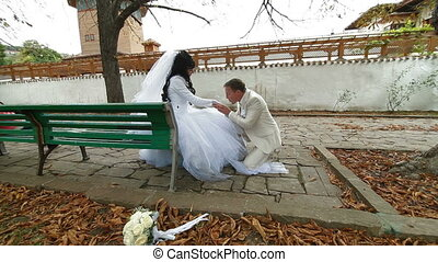 Newlyweds on  bench in autumn park