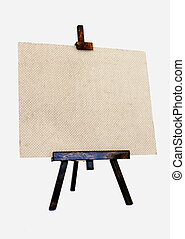 Empty canvas on a wooden easel - Empty textured canvas on a...