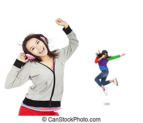 happy asian young woman listen music and dancing