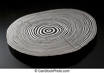 sliced wood with black and white annual rings - piece of...
