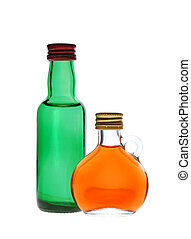Two glass small alcohol bottles isolated on white background