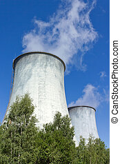 cooling towers under blue sky