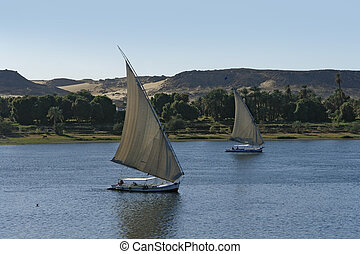 sailing boats in Egypt - waterside scenery at River Nile in...