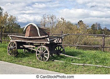 Old wagon on the background of the autumn landscape