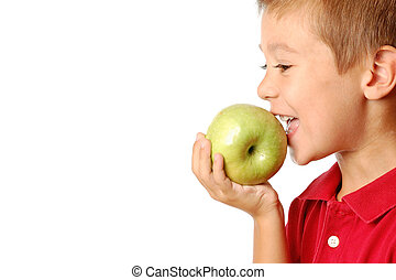 Child eats green apple isolated on white background