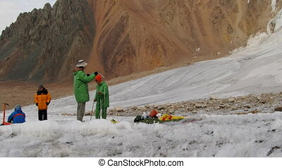 installing tent on the glacier