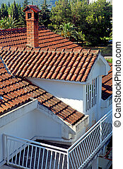 Tiled roof - A house with a tiled roof