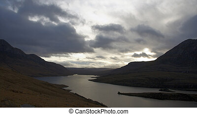 landscape near Stac Pollaidh at evening time - waterside...