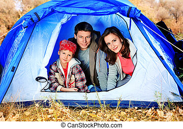 looking out - Happy family having a rest outdoor in tent.