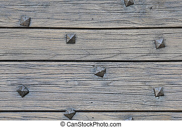 Wood planks with square nails texture that perfectly loop horizontally and vertically