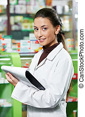 Pharmacy chemist woman in drugstore - positive pharmacist...
