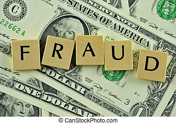 Fraud - Word fraud in lettern on background of dollar...