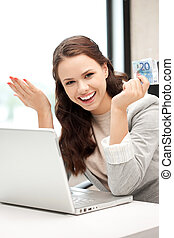 happy woman with computer and euro cash money - picture of...