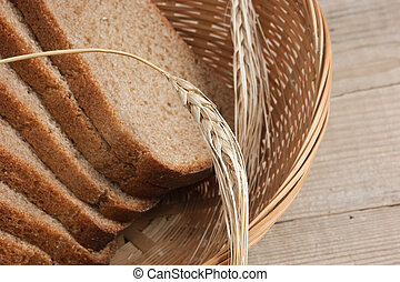 slices of rye bread and ears of corn in basket - slices of...