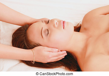 Woman in reiki session - Attractive young woman in reiki...