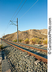 Railway track - Electrified railway track running across a...