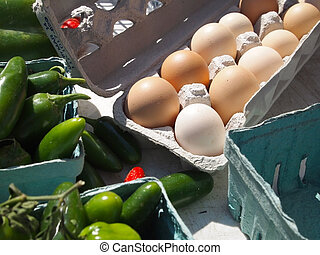 Fresh Brown Organic Eggs - A carton of fresh brown eggs for...