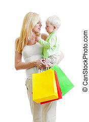Standing mother with son and colorful paper shopping bag isolated on white