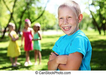 Boy in the summer park