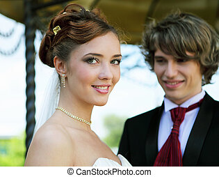 shot young couples entering into marriage - A shot young...