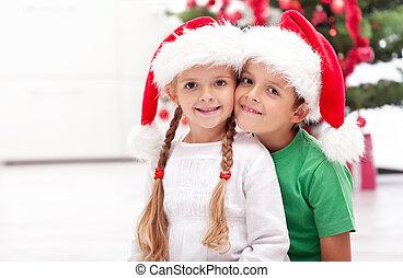 Happy siblings at christmas time