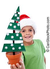 Happy kid holding christmas decoration