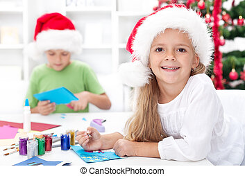 Happy kids making christmas cards