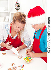 Making decorated christmas cookies - Woman and child making...