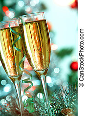 Party - Two champagne flutes on Christmas background