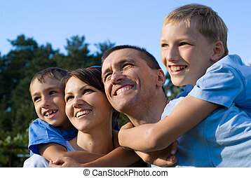 nice family outside - portrait of a nice family at nature