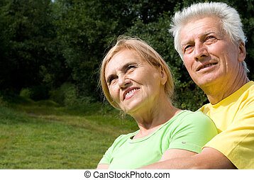 cute old couple at nature - portrait of a cute old couple at...