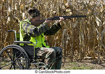 hunter safety in a wheelchair - disabled hunter in a safety...