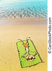 Fun in the sun concept - funny cartoon laying on a towel and...