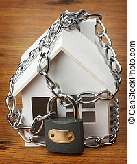house with chain and padlock, home security concept