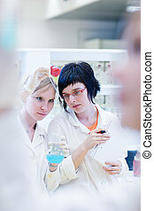 female researchers carrying out research together in a...