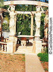 Arbor in garden - Marble arbor with statues in the garden