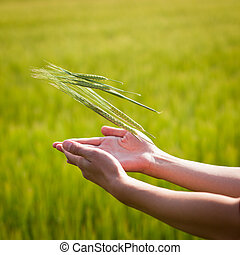 Symbolic gesture suggesting fertility, plenitude, health